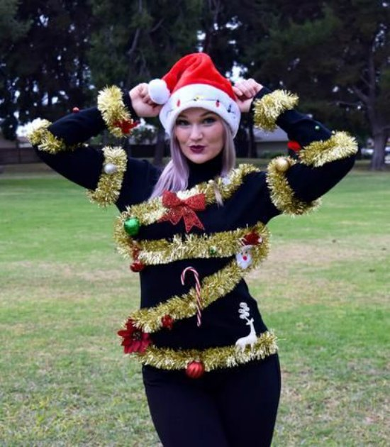 We love this festive ugly sweater idea. You take an old sweater and create this chic feel the Christmas sweater. Glue in candy cane, reindeer, Santa, ...